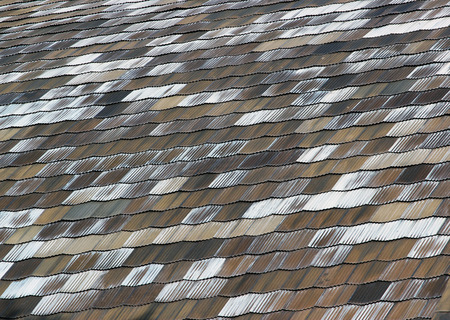 biased: Old metal shingles roof texture background