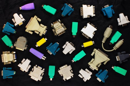 adapters: different pc connectors and adapters on black background