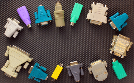 adapters: Different computer connectors and adapters on black background