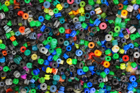 rubber gasket: colorful medley of rubber washers pads gaskets background Stock Photo