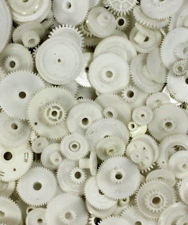 cogwheels: plastic gears and cogwheels as a background. Stock Photo