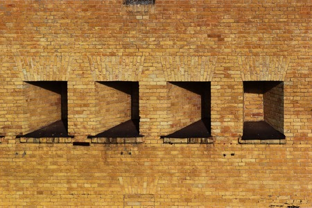 inset: Niches in thick wall. Detail fragment of brick structure Stock Photo