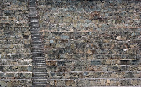 unkept: Background of old stone stairs in amphitheater