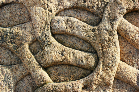 carved stone: Carved stone bas relief of entwined vine