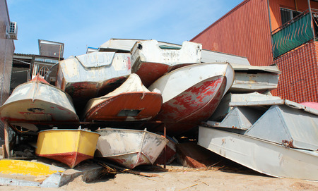 motorboats: Dumped old motorboats Stock Photo