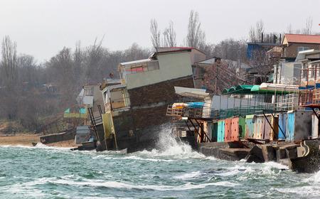 Coastal erosion - houses built on weak clay soil slide down to the sea in Odessa, Ukraine.