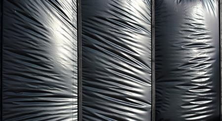 creasy: Black swollen polyethylene foil as background