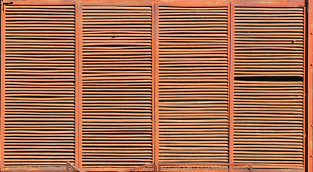 grille: Background of rusty brown metal ventilation grille Stock Photo