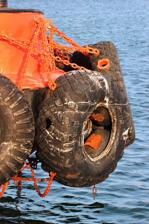 fender: Old used car tires as fender on a shipboard