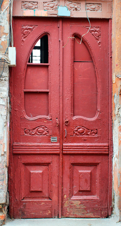 tacky: Red wooden door in a residential house, Odessa, Ukraine Stock Photo