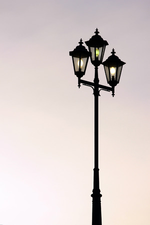 artificial lights: Old street lamppost against twilight background Stock Photo