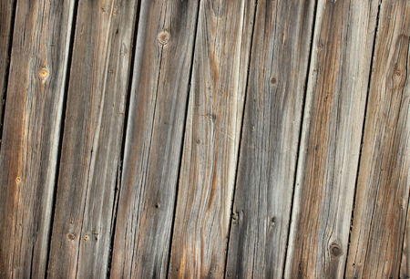 skewed: Wooden aged background. Light weathered wooden texture. Skewed vertical planks. Stock Photo