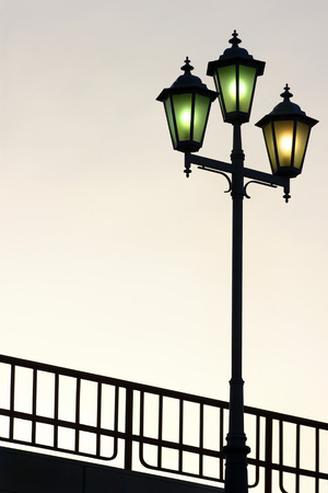 electric avenue: Old street lamppost against twilight background Stock Photo