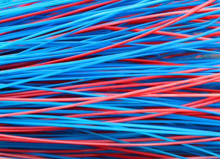 straw twig: Colorful red and blue stems of plastic broom closeup Stock Photo