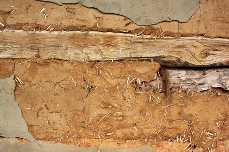 earthen: Old wooden and earthen wall