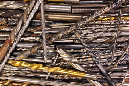 borer: Many old dirty used metal drill bits as background
