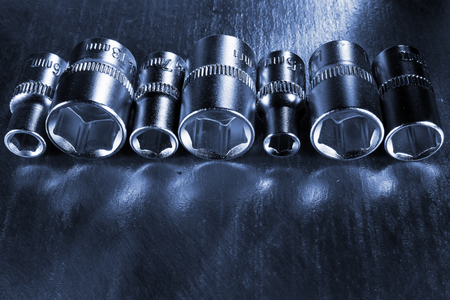 sockets: Set of stainless steel hex sockets on shiny metal surface
