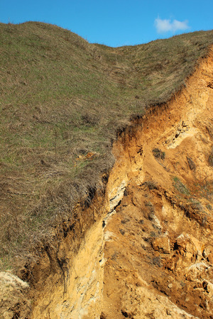 exposed: Eroded soil - red clay exposed Stock Photo