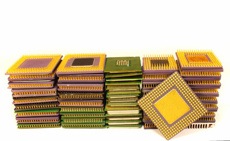 processors: Stacks of old CPU chips and obsolete computer processors Stock Photo
