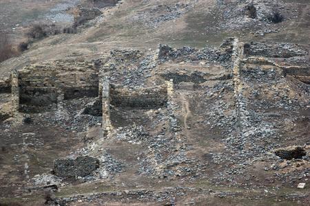 pagan: Ruins of ancient houses near cave pagan city Uplistsihe, Georgia at wintertime