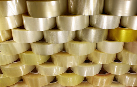 Many rolls of transparent packing sticky tape