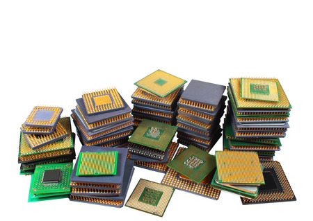 processors: Stacks of old CPU chips and obsolete computer processors isolated on white background