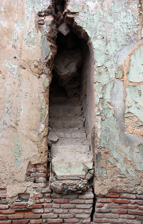 demolish: Blocked up staircase in old demolished wall opening Stock Photo