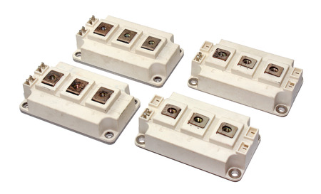 4 of a kind: Powerful IGBT transistors isolated on white background Stock Photo