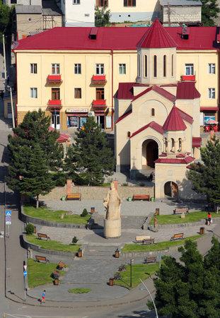regnant: AKHALTSIKHE, GEORGIA - JUNE 14,2016: Monument to Queen Tamar of Georgia and Amaghleba Church in center of  Akhaltsikhe city. Tamar was Queen regnant of Georgia in 12th century, the Georgian Golden Age