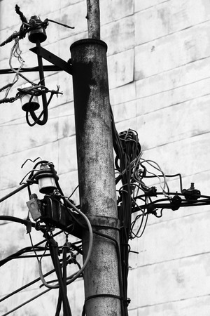 powerline: Powerline insulators, connectors and tangled wires on electrical pole