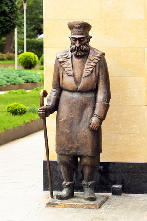 groundskeeper: TBILISI, GEORGIA - JUNE 19, 2016: Sculpture of traditional street cleaner in historical center of Old Tbilisi, based on painting by famous georgian artist Niko Pirosmani.