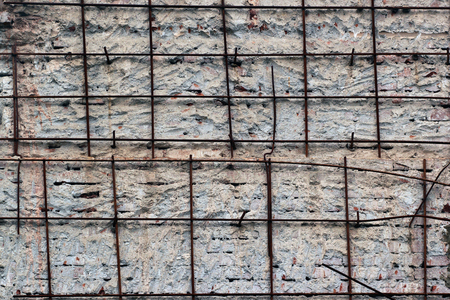 reinforcement: Rusty iron reinforcement bars in concrete wall