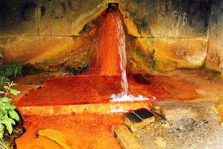 seltzer: Narzan mineral water spring in Caucasus mountains, Georgia. High concentration of iron gives it rusty orange color.