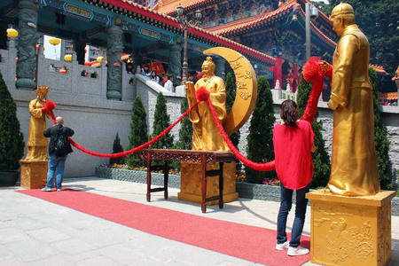 HONG KONG, MARCH 22, 2012: Statue of Yue Lao, or old man under the moon, chinese god of marriage at Sik Sik Yuen Wong Tai Sin Taoist Temple in Kowloon, Hong Kong.