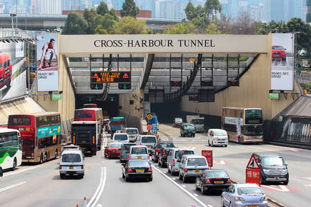 HONG KONG, MARCH 22, 2012: Cross Harbour Tunnel, the first underwater passage connecting both sides of Victoria Harbour. 1.8 km long tunnel crossing opened in 1972. It provides road link between Kowloon and Hong Kong Island. Редакционное