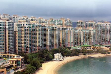 HONG KONG, MARCH 5, 2012: Park Island apartment complex and Ma Wan Tung Wan Beach on Ma Wan island in Tsuen Wan, New Territories, Hong Kong. Residential buildings often occupy beaches and coastal regions.