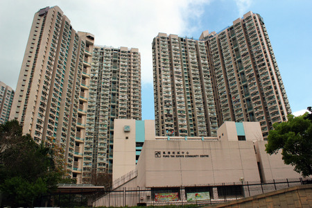 public housing: HONG KONG, MARCH 22, 2012: Fung Tak estate in Diamond Hill, completed in 1991. Through mass public housing programmes the Government of Hong Kong provides affordable housing for lower-income residents. Editorial