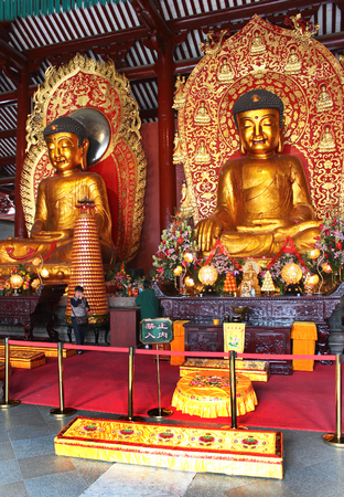 GUANGZHOU, CHINA, MARCH 5, 2012: Big Buddha Temple (Da Fo Si), one of five renowned Buddhist temples in Guangzhou. The three 6-meters tall 10-tonne bronze Buddha statues represent the past, present and future.