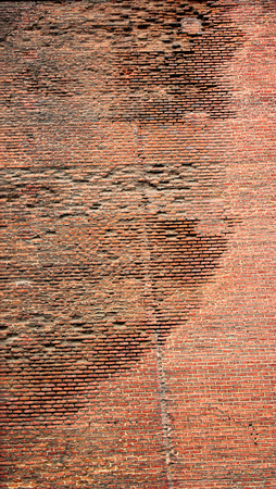 Old abandoned destroyed red brick wall Stock Photo