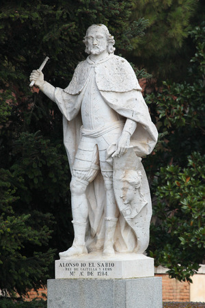MADRID, SPAIN - DECEMBER 13, 2016: Sculpture of Alfonso X the Wise, King of Castile, Leon and Galicia, near the Royal Palace of Madrid. He reigned from 1252 until his death in 1284. Editorial