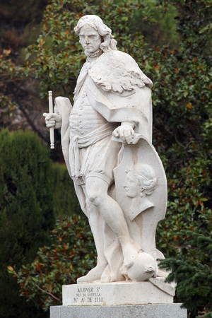 near death: MADRID, SPAIN - DECEMBER 13, 2016: Sculpture of Alfonso VIII the Noble, the King of Castile and Toledo, near the Royal Palace of Madrid. He reigned from 1158 to his death in 1214.