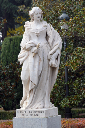 MADRID, SPAIN - DECEMBER 13, 2016: Sculpture of Isabella I, Queen of Castile, near the Royal Palace of Madrid. She reigned from 1474 to 1504 and was married to Ferdinand II of Aragon.
