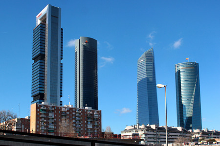 MADRID, SPAIN - DECEMBER 18, 2016: Four skyscrapers in the Cuatro Torres Business Area. Crystal, Space, Pwc and CEPSA Towers are the tallest buldings in country.