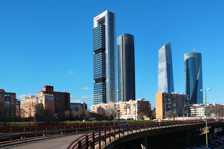 MADRID, SPAIN - DECEMBER 18, 2016: Four skyscrapers in the Cuatro Torres Business Area. Crystal, Space, Pwc and CEPSA Towers are the tallest buldings in the country.