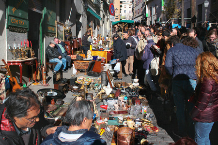 MADRID, SPAIN - DECEMBER 18, 2016: El Rastro, most popular open air flea market held every Sunday and visited by over 100,000 people and tourists.