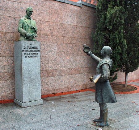 discoverer: MADRID, SPAIN - DECEMBER 16, 2016: Tribute statue of grateful bullfighters to Dr. Fleming, discoverer of penicillin, near Las Ventas bullring in Madrid.