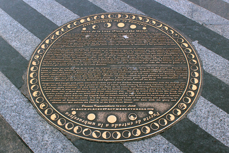 intersects: MADRID, SPAIN - DECEMBER 15, 2016: Marker of Kcymaerxthaere at Plaza de la Luna. Parallel universe that intersects in some points with our linear Earth was created by Eames Demetrios.