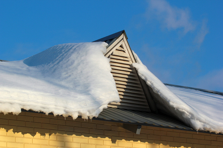 sopel lodu: Roof window covered with snow