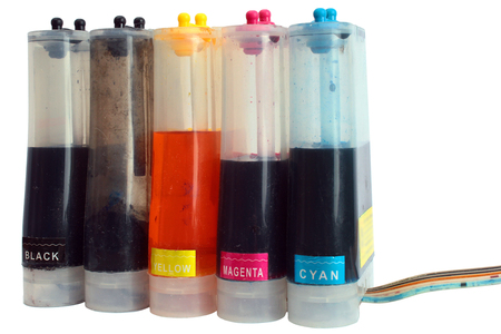 Bottles of continuous ink supply system for a retrofit inkjet printer, isolated on white background