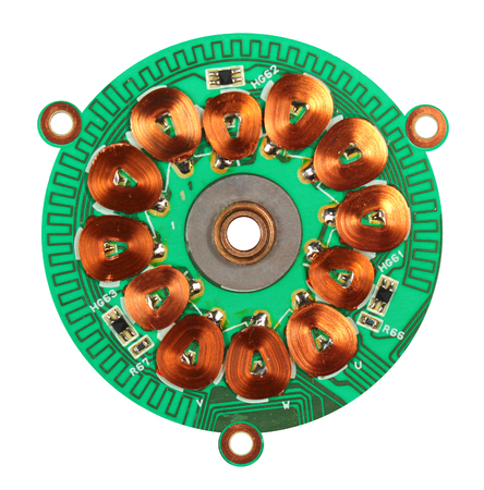 windings: Brushless dc motor with removed upper cover and magnet rotor. Hall sensors, copper coils and windings on printed circuit board. Isolated against white background. Stock Photo